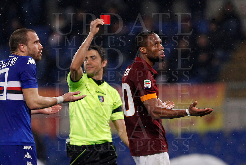 Calcio, Serie A: Roma vs Sampdoria. Roma, stadio Olimpico, 16 marzo 2015. <br /> Referee Gianpaolo Calvarese, center, gives a red card to Roma&rsquo;s Seydou Keita during the Italian Serie A football match between Roma and Sampdoria at Rome's Olympic stadium, 16 March 2015.<br /> UPDATE IMAGES PRESS/Isabella Bonotto