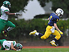 Garrett Gibbons #7 of Massapequa tries to stay on his feet after breaking a tackle and rushing for a long gain in the first quarter of a Nassau County Conference I varsity football game against Farmingdale at Massapequa High School on Saturday, Oct. 8, 2016. Farmingdale won by a score of 45-42.