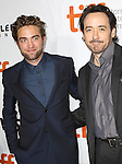 Robert Pattinson and John Cusack attend the Red Carpet Arrivals for 'Maps To The Stars' at the Roy Thomson Hall during the 2014 Toronto International Film Festival on September 9, 2014 in Toronto, Canada.