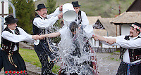 "Men hold onto a woman as they throw water at her, as part of traditional Easter celebrations, during a media presentation in Holloko, 100 km (62 miles) east of Budapest, Hungary on April 14, 2011..Locals from the World Heritage village of Holloko, celebrate Easter with the traditional ""watering of the girls"", a Hungarian tribal fertility ritual rooted in the area's pre-Christian past. ATTILA VOLGYI"