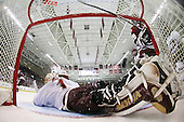 Philip Samuelsson (BC - 5), Matt Price (BC - 25) and James Marcou (UMass - 19) watch Wellman's shot head to the back of the net over John Muse (BC - 1). - The Boston College Eagles defeated the University of Massachusetts-Amherst Minutemen 5-2 on Saturday, March 13, 2010, at Conte Forum in Chestnut Hill, Massachusetts, to sweep their Hockey East Quarterfinals matchup.