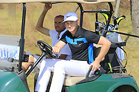 Oliver Fisher (ENG) takes the wheel for the start of Tuesday's Pro-Am Day of the 2014 BMW Masters held at Lake Malaren, Shanghai, China 28th October 2014.<br /> Picture: Eoin Clarke www.golffile.ie
