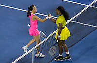 Serena Williams of USA with Agnieszka Radwanska of Poland in action at the Australian Open