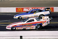 Feb. 1995; Pomona, CA, USA; NHRA funny car driver Gary Bolger (near) races Gary Densham during the Winter Nationals at the Pomona Fairplex. Mandatory Credit: Mark J. Rebilas-