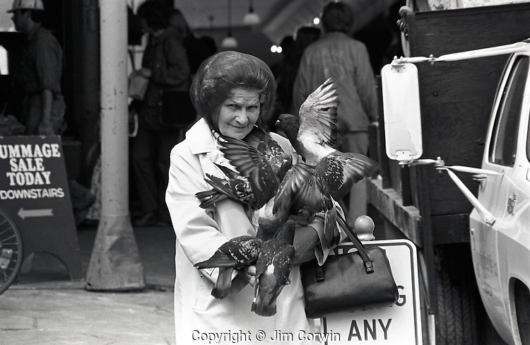Older woman feeding pigeons at the Pike Place Market
