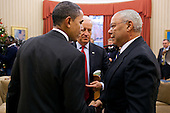 United States President Barack Obama and Vice President Joe Biden talk with former Secretary of State Colin Powell following their meeting in the Oval Office,  December 1, 2010. .Mandatory Credit: Pete Souza - White House via CNP