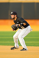 Second baseman Pat Blair #11 of the Wake Forest Demon Deacons on defense against the Miami Hurricanes at Gene Hooks Field on March 18, 2011 in Winston-Salem, North Carolina.  Photo by Brian Westerholt / Four Seam Images