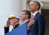United States President Barack Obama (R), Chairman of the Joint Chiefs of Staff Gen. Joseph Dunford (L) and Defense Secretary Ashton Carter listen to the National Anthem at the conclusion of remarks at the Amphitheater at Arlington National Cemetery, Arlington, Virginia, on Memorial Day, May 30, 2016, near Washington, DC. Obama paid tribute to the nation's military service members who have fallen.  <br /> Credit: Mike Theiler / Pool via CNP