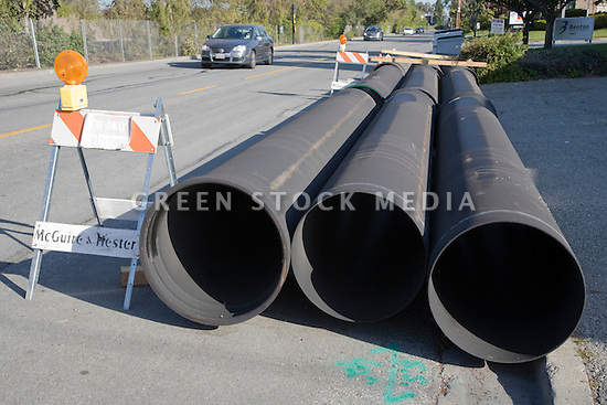 "These 24"" diameter pipes of recycled steel will be covered with purple plastic sleeves and installed underground as part of a reclaimed water pipeline. The cities of Palo Alto and Mountain View are jointly constructing a reclaimed water pipeline to carry recycled water from the Palo Alto Regional Water Quality Control Plant to customers along East Bayshore Parkway and Mountain View's North Bayshore area."