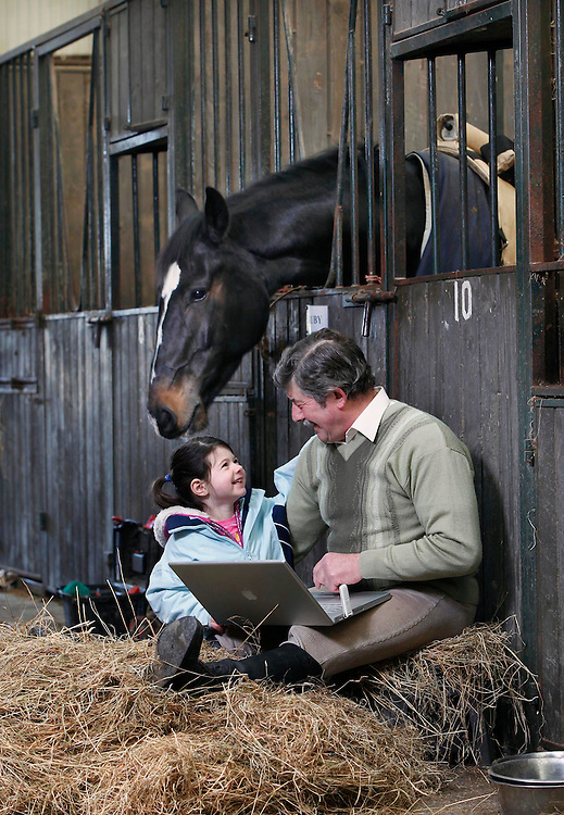 No Repro Fee....No More Horsing Around, email Santa in time for Christmas.....Aimee Heavey, age 4 from Naas, Co. Kildare pictured here with her grandfather Liam Gaffney in his stables, Co. Naas emailing Santa their last orders in time for Christmas because of 3 Ireland and the National Broadband Scheme which brings broadband to rural areas countrywide. Pic. Robbie Reynolds/CPR