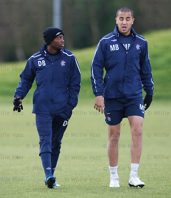 DaMarcus Beasley walking beside the towering figure of Madjid Bougherra