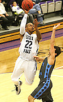 SIOUX FALLS, SD - DECEMBER 5:  Charles Ward #22 from the University of Sioux Falls looks to the basket past Luke Lenhart #0 from Upper Iowa in the second half of their game Friday night at the Stewart Center.  (Photo by Dave Eggen/inertia)