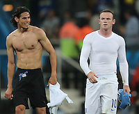 England's Wayne Rooney and Edison Cavani after  2-1 defeat