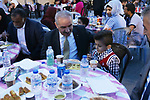 Palestinian Prime Minister Mohammad Ishtayeh attends Ramadan break fast in an iftar celebration held to the families of martyrs and prisoners in the West Bank city of Nablus, May 26, 2019. Photo by Prime Minister Office