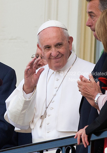 Pope Francis waves from a balcony on the West Front of the United States Capitol in Washington, DC after delivering an address to a Joint Session of the US Congress in Washington, DC on Thursday, September 24, 2015.<br /> Credit: Chris Kleponis / CNP<br /> (RESTRICTION: NO New York or New Jersey Newspapers or newspapers within a 75 mile radius of New York City)
