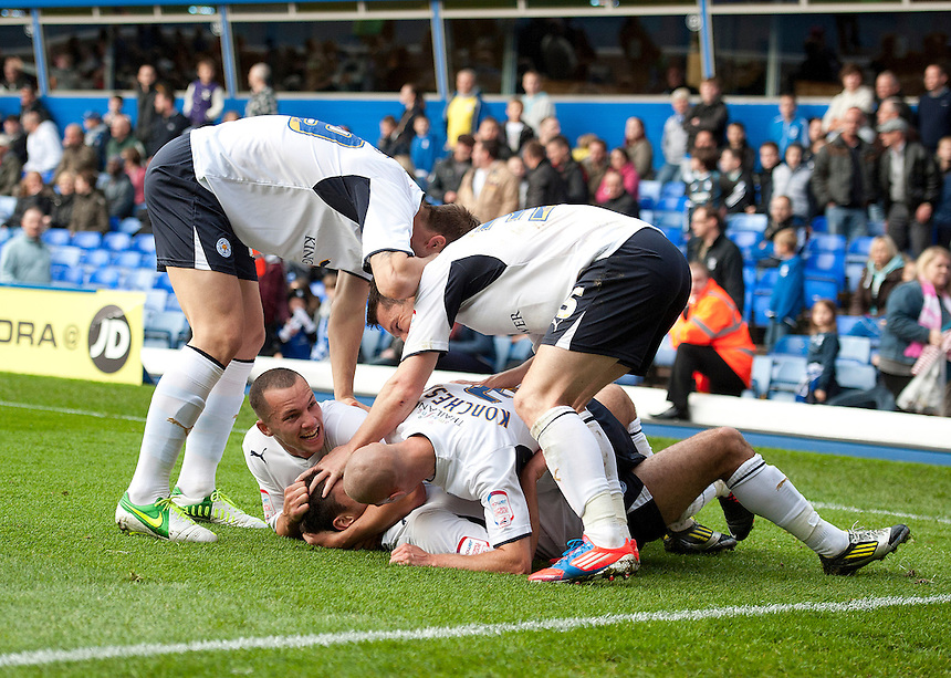 Leicester City's Ben Marshall is swmped by team-mates celebrating his late equalising goal securing a 1-1 draw..Football - npower Football League Championship - Birmingham City v Leicester City - Saturday 20th October 2012 - St Andrews - Birmingham..
