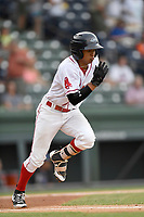 Right fielder Lorenzo Cedrola (5) of the Greenville Drive runs out a batted ball in a game against the Asheville Tourists on Wednesday, August 2, 2017, at Fluor Field at the West End in Greenville, South Carolina. Greenville won, 1-0. (Tom Priddy/Four Seam Images)