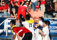 Coach Caleb Porter of the University of Akron gets a soaking at the end of  the 2010 College Cup final against the University of Louisville at Harder Stadium, on December 12 2010, in Santa Barbara, California. Akron champions, 1-0.