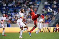 Tony Tchani (32) plays the ball in front of Thierry Henry (14) of the New York Red Bulls. The New York Red Bulls defeated Toronto FC 5-0 during a Major League Soccer (MLS) match at Red Bull Arena in Harrison, NJ, on July 06, 2011.