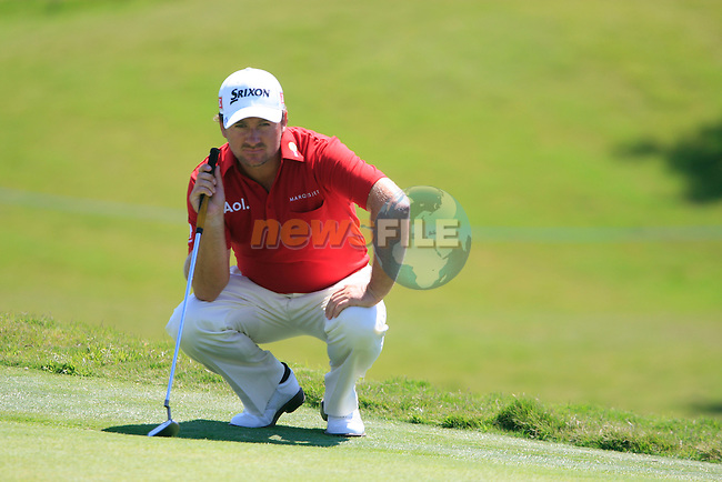 Graeme McDowell (N.IRL) lines up his putt on the 16th green during the morning session on Day 3 of the Volvo World Match Play Championship in Finca Cortesin, Casares, Spain, 21st May 2011. (Photo Eoin Clarke/Golffile 2011)