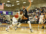 SIOUX FALLS, SD, FEBRUARY 10:  Daniel Hurtt #15 from the University of Sioux Falls drives against Zach Huisken #33 from Augustana Friday night at the Stewart Center in Sioux Falls. (Photo by Dave Eggen/Inertia)