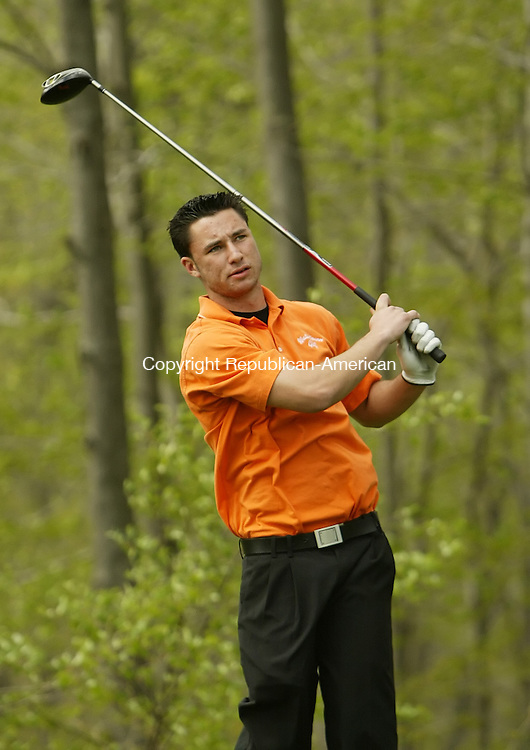 NAUGATUCK, CT, 04/30/09- 043009BZ13- Watertown's Jack Cipriano watches his tee shot on the third hole during a match against Naugatuck at Hop Brook Thursday.<br />  Jamison C. Bazinet Republican-American