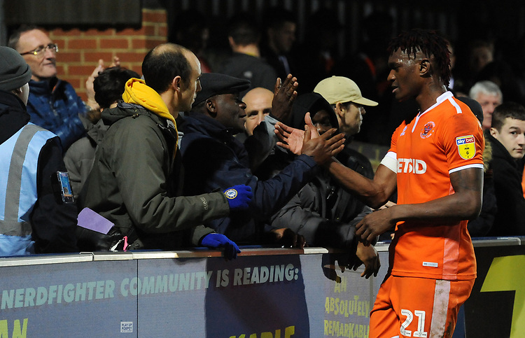 Blackpool's Armand Gnanduillet with the fans<br /> <br /> Photographer Kevin Barnes/CameraSport<br /> <br /> The EFL Sky Bet League One - AFC Wimbledon v Blackpool - Saturday 29th December 2018 - Kingsmeadow Stadium - London<br /> <br /> World Copyright © 2018 CameraSport. All rights reserved. 43 Linden Ave. Countesthorpe. Leicester. England. LE8 5PG - Tel: +44 (0) 116 277 4147 - admin@camerasport.com - www.camerasport.com