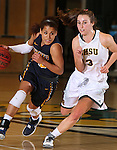 SPEARFISH, SD - JANUARY 8, 2016 -- Caresse Williams #10  of Regis drives on Julia Seamans #3 of Black Hills State during their college basketball game Friday at the Donald E. Young Center in Spearfish, S.D. (Photo by Dick Carlson/Inertia)