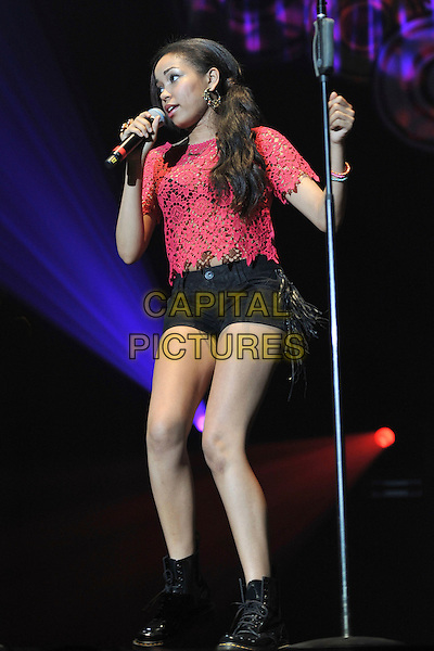 Dionne Bromfield .Performing live at the 'Girlguiding UK  Big Gig' at Wembley Arena, London, UK, 1st October 2011..music concert  live on stage full  length red lace crop top black hotpants shorts microphone singing dms doc martens boots .CAP/MAR.© Martin Harris/Capital Pictures.