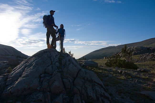 couple, (MR), standing on boulder, hiking, hike, alpine, tundra, high elevation, recreation, outdoors, activity, summer, August, morning, sky, Rocky Mountain National Park, Colorado, USA
