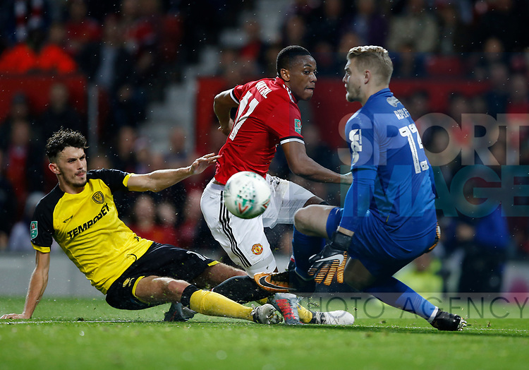 Anthony Martial of Manchester United rolls the ball wide after getting it past Connor Ripley of Burton Albion during the Carabao Cup Third Round match at the Old Trafford Stadium, Manchester. Picture date 20th September 2017. Picture credit should read: Simon Bellis/Sportimage