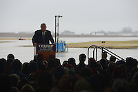 Republican Presidential front runner Donald Trump launches into his speech at the Synergy Flight Center in Bloomington, Illinois on March 13, 2016.