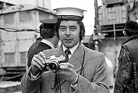 Cyril Cain, photographer, Daily Mirror, UK. Cyril was Belfast-based during much of the N Ireland Troubles. A native of the the Isle of Man he is seen wearing the cap of a crew member on board the prison ship, HMS Maidstone, moored in Belfast  197303020117a.<br /> <br /> Copyright Image from Victor Patterson, 54 Dorchester Park, Belfast, UK, BT9 6RJ<br /> <br /> t1: +44 28 9066 1296 (from Rep of Ireland 048 9066 1296)<br /> t2: +44 28 9002 2446 (from Rep of Ireland 048 9002 2446)<br /> m: +44 7802 353836<br /> <br /> e1: victorpatterson@me.com<br /> e2: victorpatterson@gmail.com<br /> <br /> www.victorpatterson.com<br /> <br /> IMPORTANT: Please see my Terms and Conditions of Use at www.victorpatterson.com