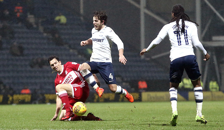 Preston North End's Ben Pearson is tackled by Middlesbrough's Stewart Downing<br /> <br /> Photographer Rich Linley/CameraSport<br /> <br /> The EFL Sky Bet Championship - Preston North End v Middlesbrough - Monday 1st January 2018 - Deepdale Stadium - Preston<br /> <br /> World Copyright &copy; 2018 CameraSport. All rights reserved. 43 Linden Ave. Countesthorpe. Leicester. England. LE8 5PG - Tel: +44 (0) 116 277 4147 - admin@camerasport.com - www.camerasport.com