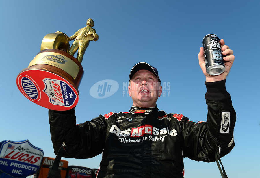 Sept. 23, 2012; Ennis, TX, USA: NHRA super gas driver Tommy Phillips celebrates after winning the Fall Nationals at the Texas Motorplex. Mandatory Credit: Mark J. Rebilas-