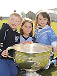 Sean Carr, Abbie Collins and Joey Nally pictured with the Sam Maguire cup at Newtown Blues GAA club. Photo: Colin Bell/pressphotos.ie