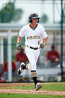 GCL Pirates second baseman Andrew Walker (62) runs to first during a game against the GCL Phillies on August 6, 2016 at Pirate City in Bradenton, Florida.  GCL Phillies defeated the GCL Pirates 4-1.  (Mike Janes/Four Seam Images)
