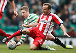 Liam Kelly wins the ball from Kris Commons