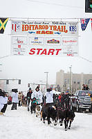 Ray Redington Jr and team leave the ceremonial start line at 4th Avenue and D street in downtown Anchorage during the 2013 Iditarod race. Photo by Jim R. Kohl/IditarodPhotos.com