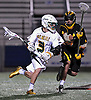Christopher Grillo #3 of Ward Melville, left, gets pressured by Matthew Kness #24 of Lakeland-Panas during the NYSPHSAA varsity boys lacrosse Class A state semifinals at Hofstra University on Wednesday, June 8, 2016