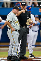 June 06, 2009:  NCAA Super Regional: Florida Gators vs Southern Miss Golden Eagles:   S. Miss. head coach Corky Palmer (44) talks with home plate umpire Jeff Henrichs prior to the start of game one of Super Regional action at Alfred A. McKethan Stadium on the campus of University of Florida in Gainesville.   Southern Miss defeated Florida 9-7 to take a 1-0 lead in the series............