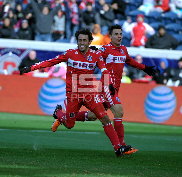 Chicago Fire forward Gaston Puerari (18) and midfielder Marco Pappa (16) celebrate Puerari's goal.  The Chicago Fire defeated Sporting KC 3-2 at Toyota Park in Bridgeview, IL on March 27, 2011.