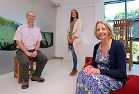 Denise Henderson (R) of Children's Cancer Charity LATCH with Erin McGeough (C) and general manager of Amazon in Swansea Pat Faulkner (L), at the Children's Hospital for Wales in Cardiff, Wales, UK