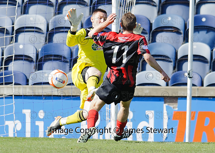 Danny Carmichael scores Queen of the South's consolation goal.
