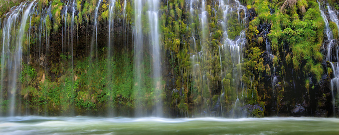Water cascades down moss laden cliffs into the Sacramento River at a unique falls in Northern California. <br /> Artist Edition: 15/200 Limited