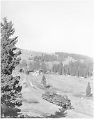 View from west of D&amp;RGW helper #486 departing from Cumbres, running light ahead of the train which will follow.<br /> D&amp;RGW  Cumbres, CO  Taken by Krause, John - ca. 1950-1955