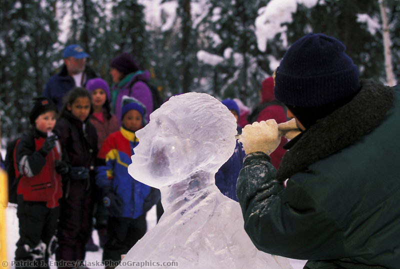 Children observe Russian Ice sculptor at the World Ice Art Championships held each march in Fairbanks, Alaska