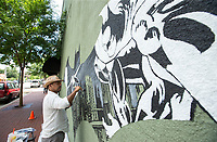 NWA Democrat-Gazette/BEN GOFF @NWABENGOFF<br /> Octavio Logo of Fayetteville paints a Batman mural Friday, June 7, 2019, during First Friday on the Bentonville square. The mural was commissioned as part of the DC Comics 'Long Live the Bat' campaign to commemorate 80 years of Batman. The campaign will feature other murals and celebrations around the world throughout the year.
