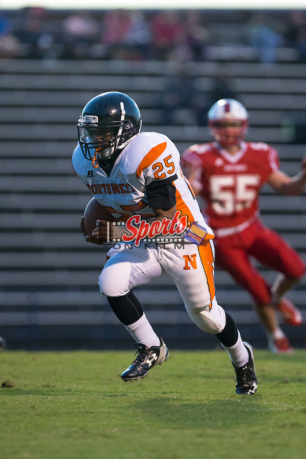 Vincent Barnett (25) of the Northwest Cabarrus Trojans runs with the football during first half action against the East Rowan Mustangs at East Rowan High School on October 8, 2015, in Salisbury, North Carolina.  The Trojans defeated the Mustangs 30-13.  (Brian Westerholt/Sports On Film)