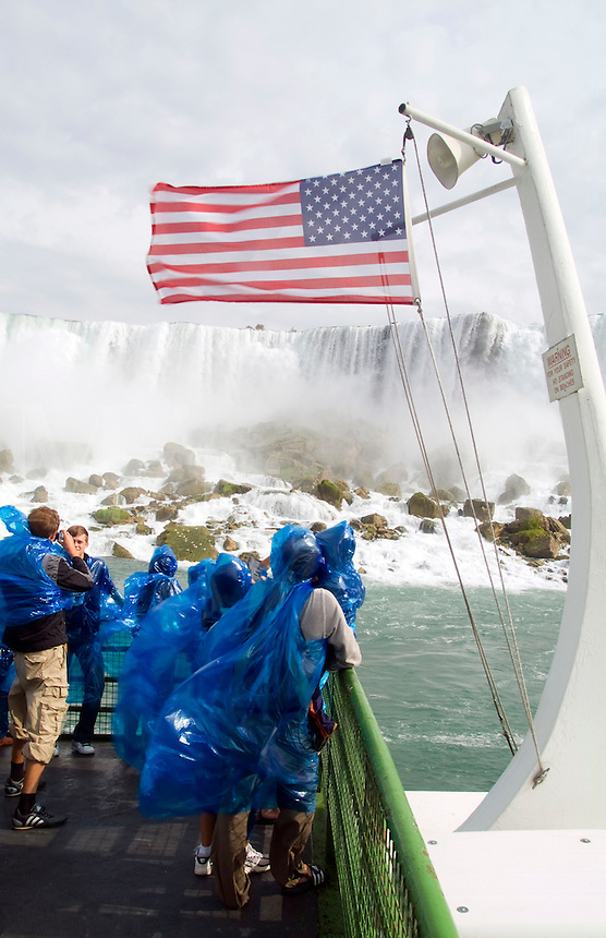 Tourists getting very wet on the Maid of the Mist boat ride at Niagara Falls, Rainbow Falls, between Canada and New York USA